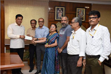 NIC Assam officials handing over cheque for flood relief to Hon'ble Chief Minister of Assam